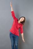 Serene young woman using her arms open wide to fly Stock Image