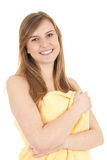 Serene young woman in yellow towel Stock Photography
