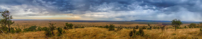 Serengeti Panorama. A panorama of the savanna and mountain range in the Serengeti National Park, Tanzania stock image