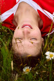 Serenity. The girl having a rest on the summer meadow, lying in a grass Royalty Free Stock Photography