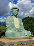 Serenity. Giant Buddha Statue against a Beautiful Sky Royalty Free Stock Images