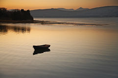 Serenity. Peaceful scene showing boat moored on the Kenmare River,Co.Kerry, Ireland at sunset Royalty Free Stock Photos