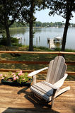 Serenity. An adirondack chair sits on a deck with a quiet cove off Chesapeake Bay near Annapolis MD Stock Image