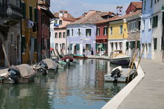 Serenity along the canal. The many colors of Venice are on display Stock Images