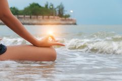 Serenity, meditation and yoga practicing. At the sea Stock Image