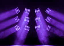 Serenity and purple square stage spotlights with a smoke on the concert. Serenity and purple square spotlights on the stage with a smoke on the concert royalty free stock image