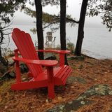 Adirondack chairs on a foggy morning royalty free stock image
