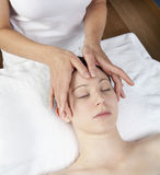 Serenity and relaxation at the spa. Palming facial massage by physiotherapist Stock Image