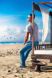Serenity relaxed man smiling happily at the sea Stock Images