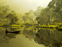 Serenity. Situ Gunung in a foggy morning during sunrise. This place is well known for the misty morning and also for its camping ground Royalty Free Stock Photography