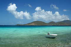 Serenity on St. John. This lonesome boat bobs gently on the green-blue waters of Leinster Bay in the USVI royalty free stock image