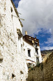 A serenity temple conner in Tibet. White clouds cover a quiet conner of a temple in Tibet,China Royalty Free Stock Photography