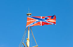 Serf Russian Navy flag on the flagpole. Against blue sky Royalty Free Stock Photo