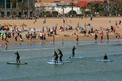 Serfing group in mediterranean waters of Valencia, Spain Royalty Free Stock Photography