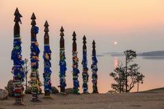 Serge Poles at Cape Burhan at sunrise. Olkhon island, Lake Baika Stock Images