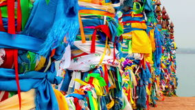 Serge. Sacred poles with colored ribbons in island Olkhon. Burkhan, Lake Baikal stock video
