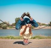 Sergey Pustovoyt. Man dancing yellow shirt blue jeans Stock Photos