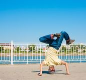Sergey Pustovoyt. Man dancing yellow shirt blue jeans sunglasses Stock Images