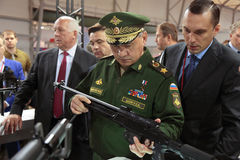 Sergey Shoygu. KUBINKA, MOSCOW OBLAST, RUSSIA - JUN 16, 2015: The Minister of Defense Sergey Shoygu examines the weapon on the stand of the concern Kalashnikov ( Stock Photos