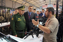 Sergey Shoygu. KUBINKA, MOSCOW OBLAST, RUSSIA - JUN 16, 2015: The Minister of Defense Sergey Shoygu examines the weapon on the stand of the concern Kalashnikov ( Stock Photo