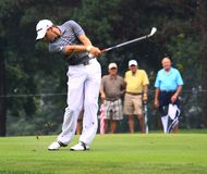 Sergio Garcia fairway shot. Sergio Garcia from Spain takes a fairway shot with a iron club. As the crowd enjoys the view at the country club golf course on the Stock Images