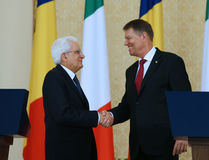 SERGIO MATTARELLA AND KLAUS IOHANNIS. Italian President Sergio Mattarella ( L ) shake hands with Romanian President Klaus Iohannis, during an official meeting Royalty Free Stock Images