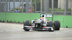 Sergio Perez racing in F1 Singapore Grand Prix Stock Photography