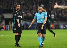Sergio Ramos and referee Cuneyt Cakir. Football players pictured during the UEFA Champions League Group H game between Tottenham Hotspur and Real Madrid on Royalty Free Stock Photography