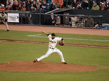 Sergio Romo steps forward to throw a pitch in rel Stock Photo
