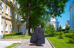 Sergiyev Posad, Russia - July 14, 2015: An orthodox priests in t. He Trinity Monastery of St. Sergius royalty free stock image
