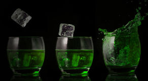 Serial arrangement of ice falling into glass of green liquid Stock Images