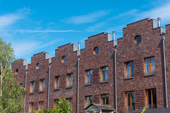 Serial houses with red bricks in Berlin Stock Photos