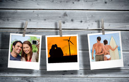 Serial instant photos of holiday scenes hung with a peg in line. With wooden boards on the background royalty free stock images