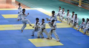 Serial kick --The seventh GoldenTeam Cup Taekwondo friendly competition Royalty Free Stock Photo