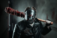 Serial murderer holding bloody baseball-bat Royalty Free Stock Images