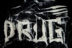Illegal drugs and pills over black background Royalty Free Stock Photography