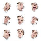 Serie de caras que miran a través de los agujeros en el papel Imagenes de archivo