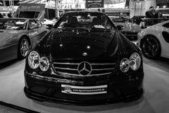 serie för Mitt--format lyxig sportbilMercedes-Benz CLK63 AMG svart, 2007 Royaltyfria Bilder