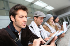 Serie of students using electronical devices Stock Images