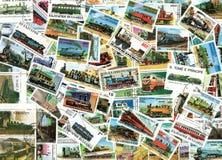 Serien und Dampfmotoren - Hintergrund der Briefmarken Stockbild