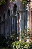 A series of arched windows of a neo-renaissance building in one point perspective image. stock photos