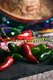 Fiesta: Hot Peppers On Slate Board With Party Decorations stock photo