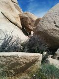 Series of balanced rocks creates tunnel. A series of balanced sandstone rocks creates a tunnel in Joshua Tree National Park stock photo