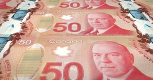 Banknotes of fifty canadian dollars rolling on screen, cash money, loop. Series of banknotes of fifty canadian dollars of the bank of Canada rolling on screen stock illustration