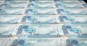 Banknotes of five bahraini dinars of Bahrain rolling, cash money. Series of banknotes of five bahraini dinars of the bank of Bahrain rolling on screen, coins of royalty free illustration