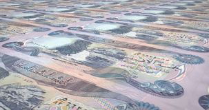 Banknotes of five thousand dinars iraq rolling, cash money, loop. Series of banknotes of five thousand iraqi dinars of the central bank of Iraq rolling on screen stock illustration