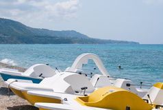 Series of boats with a slide on the beach waiting to sail Stock Image