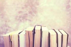 Series books at concrete background Stock Photos