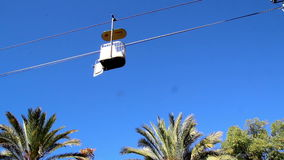 Series of cable car view of a cable cars running. Series of cable car is very helpful especially when traveling above mountains. It is also used to travel to stock footage