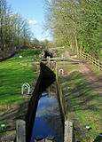 Series of Canal Locks. A long series of canal lock gates at Thorpe Salvin canal, England Royalty Free Stock Images